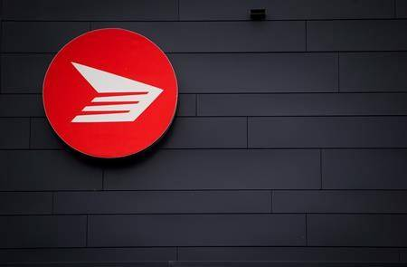 The Canada Post logo is seen on the outside the company's Pacific Processing Centre, in Richmond, B.C. (THE CANADIAN PRESS/Darryl Dyck)