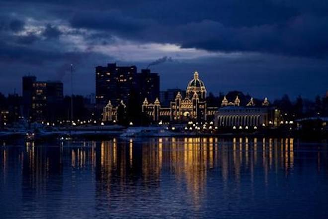 The British Columbia Legislature is reflected in the waters of Victoria harbour in the early morning in Victoria, B.C. Monday, Jan. 16, 2012. THE CANADIAN PRESS/Jonathan Hayward