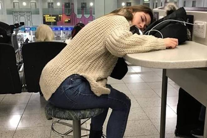 A waiting passenger sleeps at Gatwick Airport in England, Friday, Dec. 21, 2018. (AP Photo/Kirsty Wigglesworth)