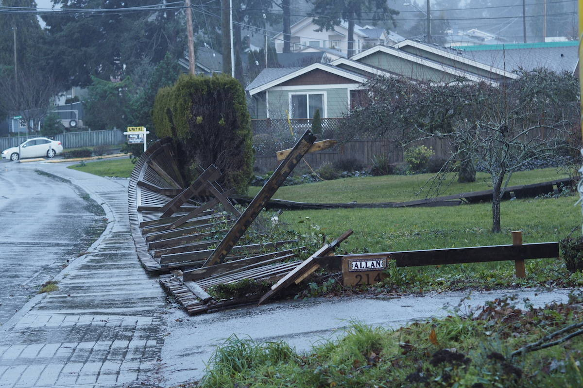 A fallen fence in Ladysmith yesterday afternoon is a more ordinary example of the sort of widespread property damage caused across the Island by yesterday's windstorm (Gerry Beltgens photo)