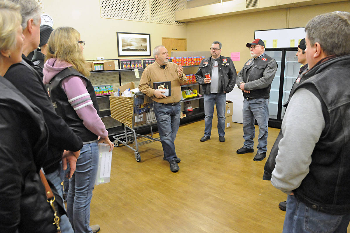 Langley Food Bank executive director Iain Mair told the Langley-based Indian Motorcycle Riders Group their donation of cash and food will help the food bank help 1,700 clients. The club dropped Saturday. Black Press photo