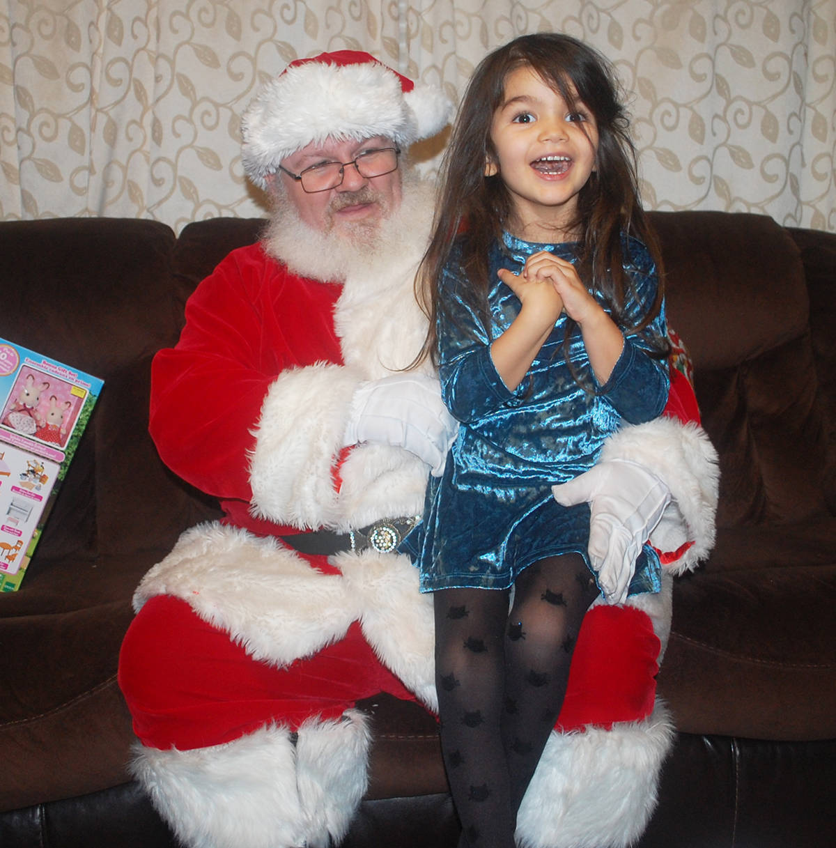 KURT LANGMANN PHOTO Santa Claus paid a special visit to Ariel Seydel and her family in her home on Saturday.