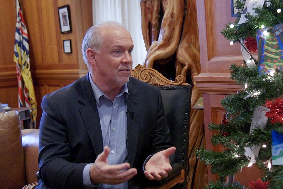 Premier John Horgan in his B.C. legislature office, Dec. 13, 2018. (Arnold Lim/Black Press)