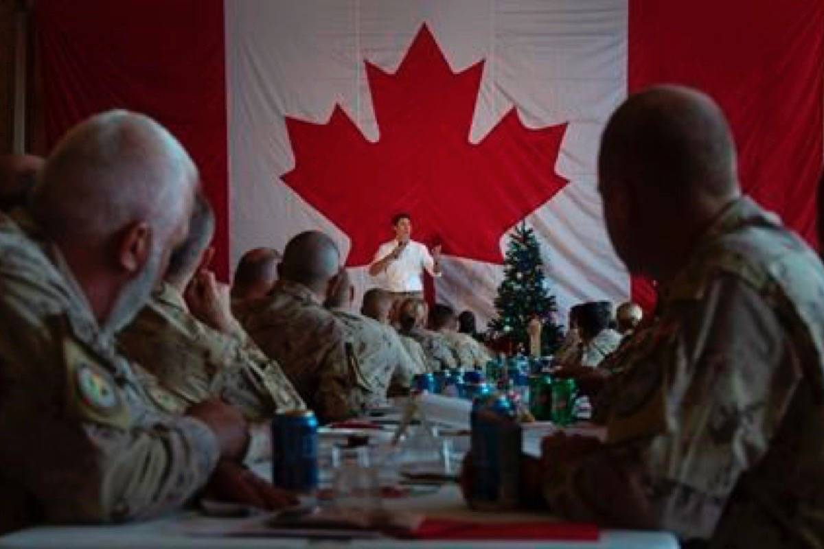 Canadian Armed Forces personnel serving on the United Nations Multidimensional Integrated Stabilization Mission listen as Prime Minister Justin Trudeau speaks to them following a turkey dinner in Gao, Mali, Saturday December 22, 2018. (Adrian Wyld/The Canadian Press)