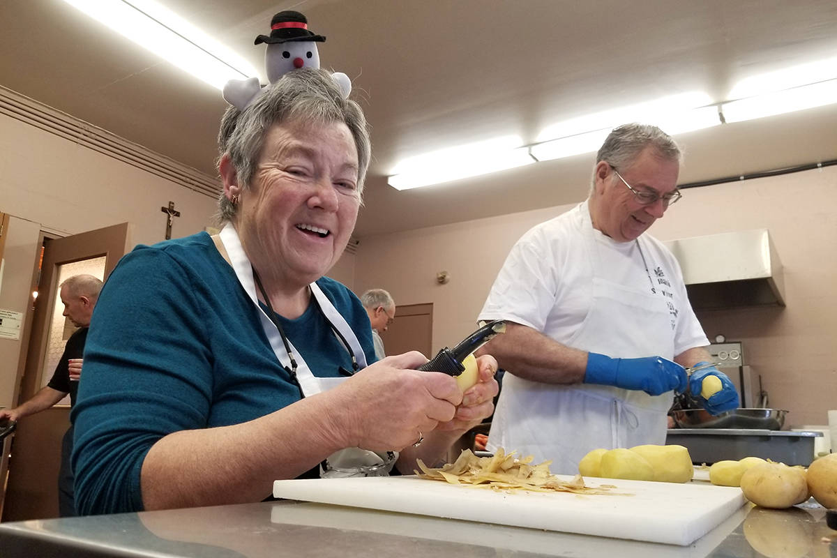 Volunteers Joan Gendron and Moe Tremblay were peeling potatoes to prepare for the 26th annual Christmas dinner for the needy at St. Joe's in Langley. Black Press photo