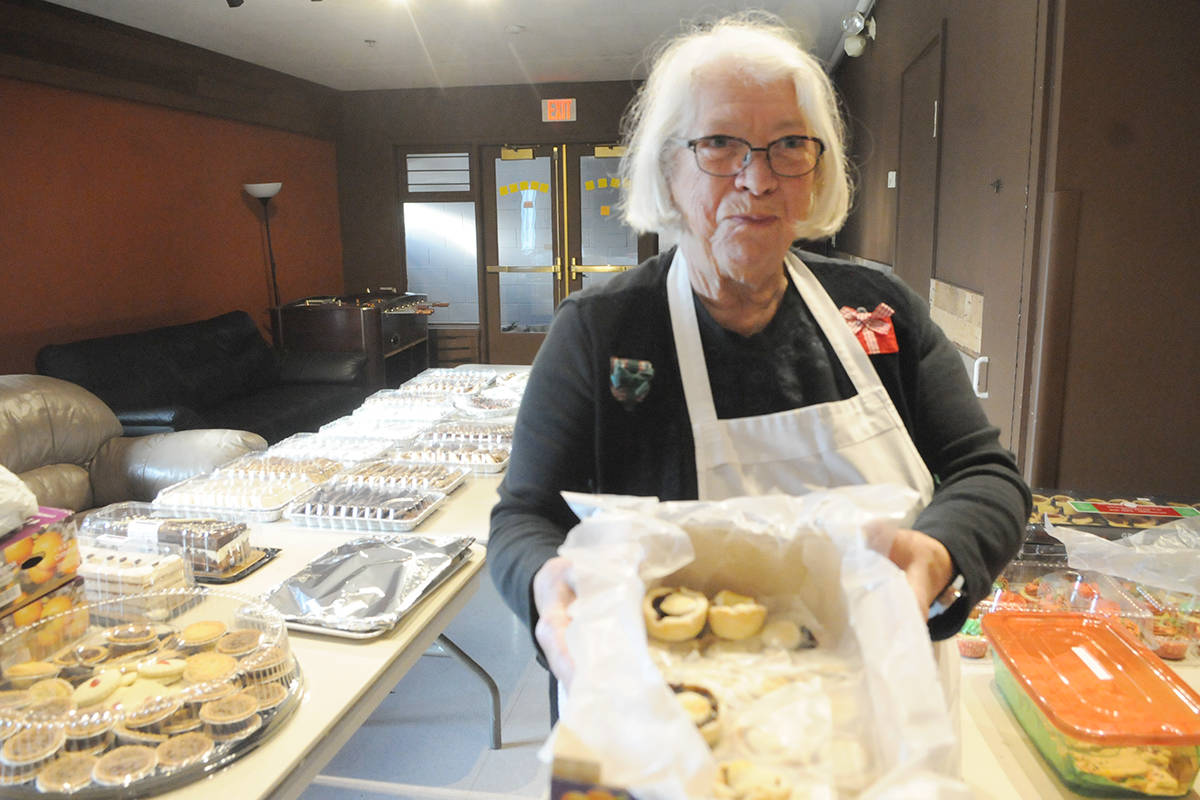 In a side room, dessert coordinator Elaine Ripka was sorting through donated home-made treats. Black Press photo