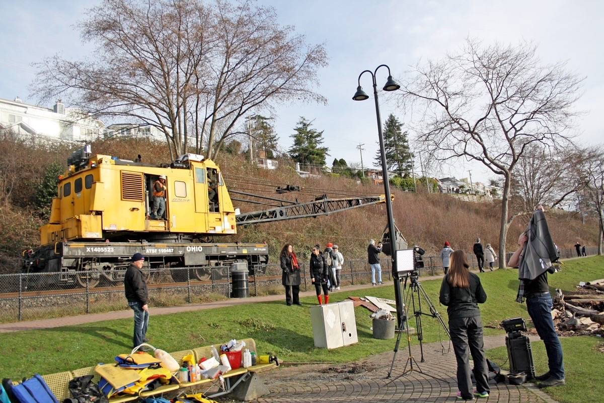 BNSF runs heavy equipment along the waterfront rail line Friday, to effect repairs to the roadbeds north and south of White Rock, according to officials. (Katya Slepian photo)