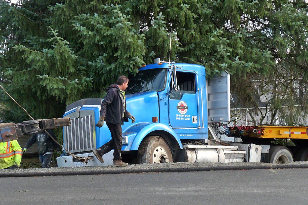 VIDEO: Semi rolls down incline, loses load