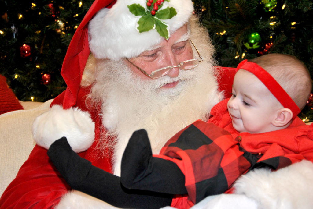 Santa Claus visited with Willoughby's five-month-old Jayda Lane recently, during one of his final days of the season at Willowbrook Shopping Centre. He'll be heading back to the North Pole soon, to prepare for his round-the-world, one-night-only toy delivery blitz – which is rumoured to be followed by a much needed three-month vacation. (Roxanne Hooper/Black Press)