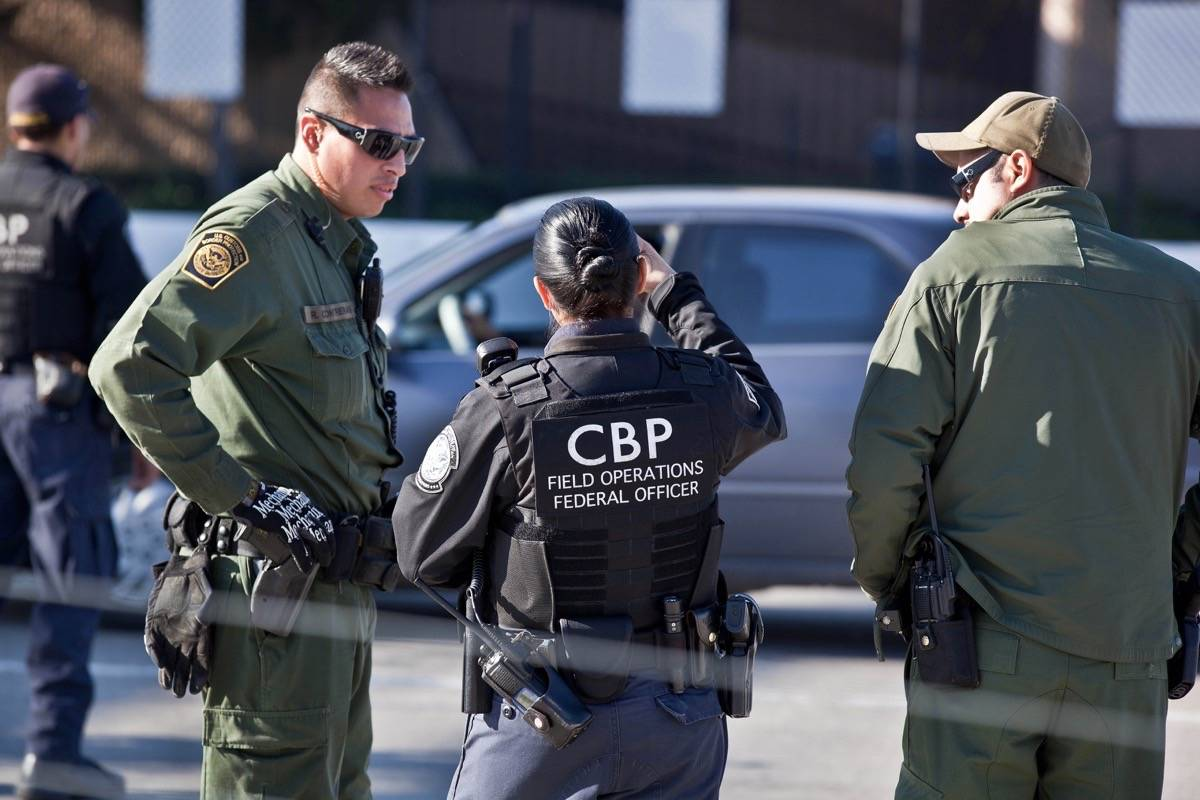 U.S. Customs and Border Protection officers. (Josh Denmark/Flickr)