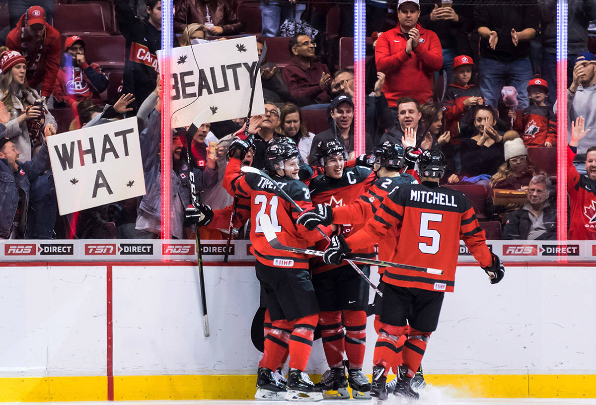 Canada's Owen Tippett, from left to right, Maxime Comtois, Evan Bouchard and Ian Mitchell celebrate Comtois' goal against Denmark during second period IIHF world junior hockey championship action in Vancouver, on Wednesday December 26, 2018. (Darryl Dyck/The Canadian Press)