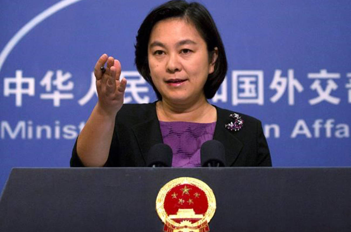 China's state media say a Canadian charged with smuggling drugs will be in court for an appeal on Saturday. Chinese foreign ministry spokeswoman Hua Chunying gestures during a press briefing at the Ministry of Foreign Affairs building in Beijing on Sept. 15, 2017. THE CANADIAN PRESS/AP-Mark Schiefelbein
