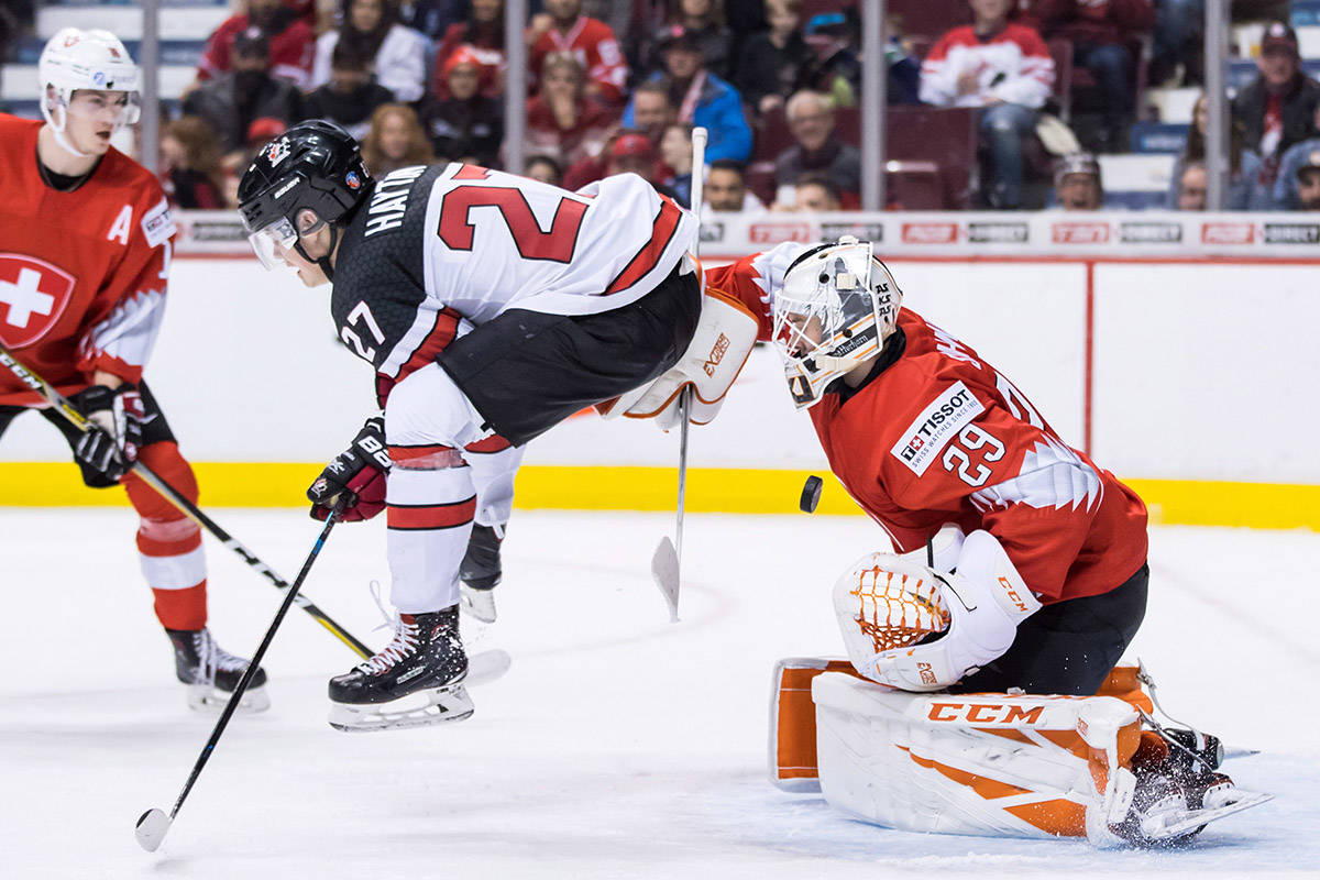 Canada's Barrett Hayton (27) jumps in front of Switzerland goalie Akira Schmid as he makes the save during second period IIHF world junior hockey championship action in Vancouver, on Thursday December 27, 2018. THE CANADIAN PRESS/Darryl Dyck