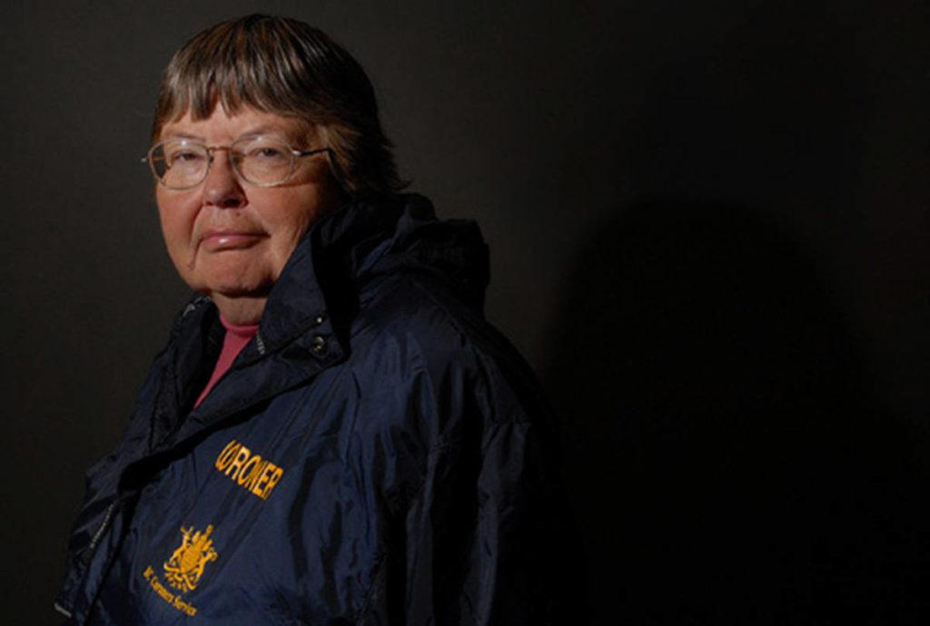 Former journalist turned coroner, Barb McLintock, photographed in her coroner's jacket in her office boardroom. (Don Denton/Black Press Media)