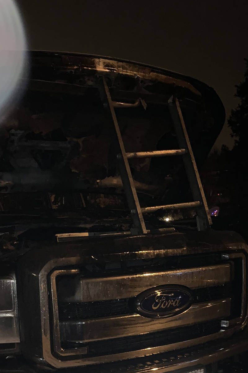 Michael Magdalenich's Ford F250 truck was a complete write-off, his work ladders melting from the ladder racks, after the fire in the 2100-block of Neil Street that started just after 3 a.m. Dec. 28. (Michael Magdalenich photo)