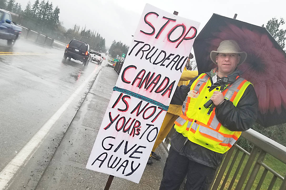 Protester Vincent Rorke was one of about a dozen people who took part in a 'yellow vest' protest on the 232 Street overpass in Langley. Black Press photo