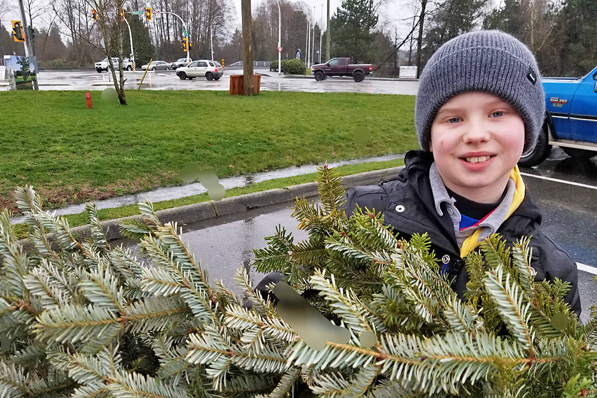 Matthew Kennedy, 9, unloaded a tree at one of the first tree-chipping events in the Langleys on Saturday. Black Press photo