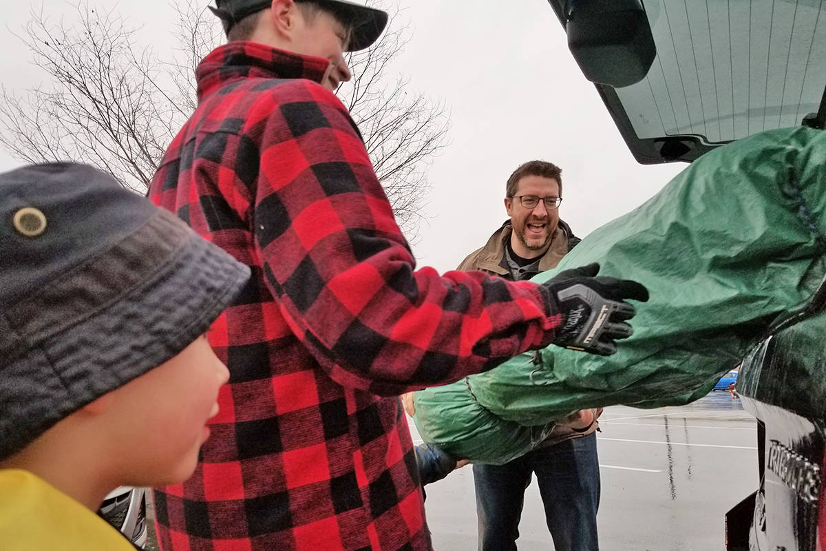 John Mair brought his tree in all wrapped up in the back of his SUV. Black Press photo