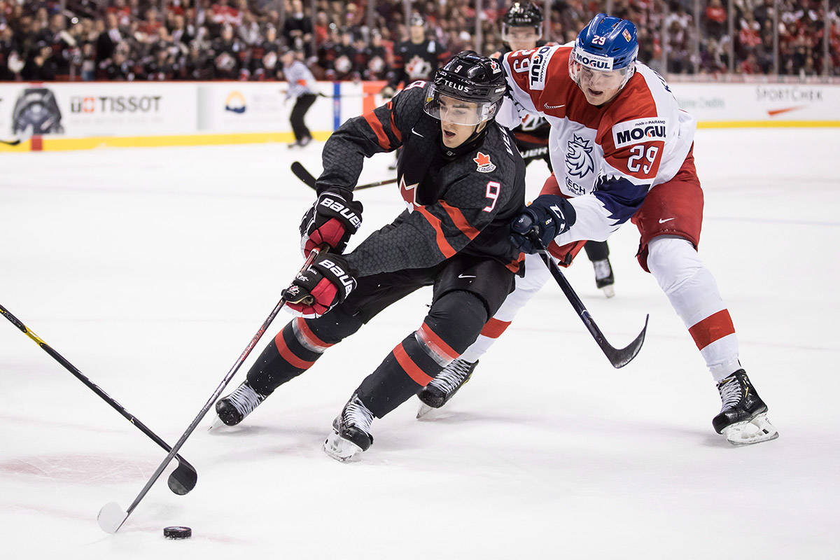 Canada's Joe Veleno (9) reaches for the puck in front of Czech Republic's Jachym Kondelik (29) during first period IIHF world junior hockey championship action in Vancouver, on Saturday December 29, 2018. THE CANADIAN PRESS/Darryl Dyck