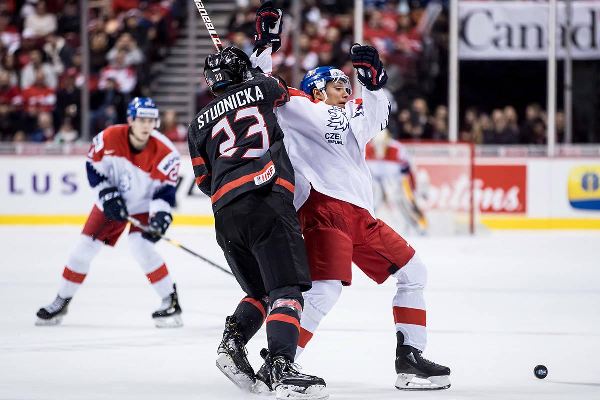 Canada's Jack Studnicka, left, checks Czech Republic's Jakub Galvas during second period IIHF world junior hockey championship action in Vancouver, on Saturday December 29, 2018. THE CANADIAN PRESS/Darryl Dyck
