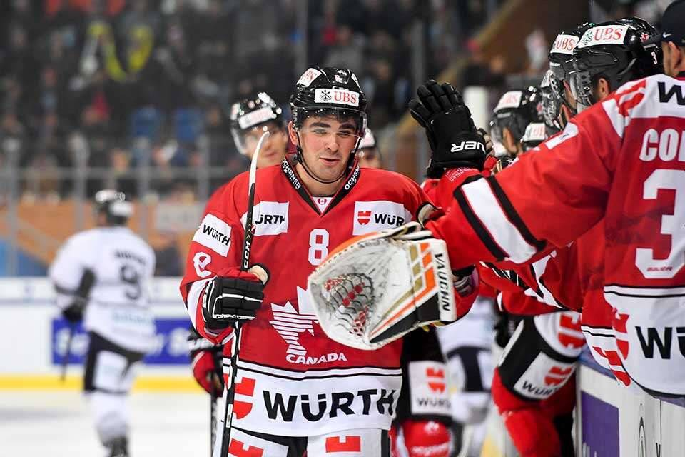 Dante Fabbro (No. 8) picked up two goals in an earlier game at the Spengler Cup, and added an assist in Sunday's 4-2 semifinal win over the Nürnburg Ice Tigers in Davos, Switzerland. Keystone photo