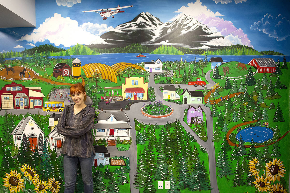 Jessica Barbour spent about a month painting a Langley-inspired mural at Murals Medical Clinic. Courtesy Tyler Seib, All In One Productions