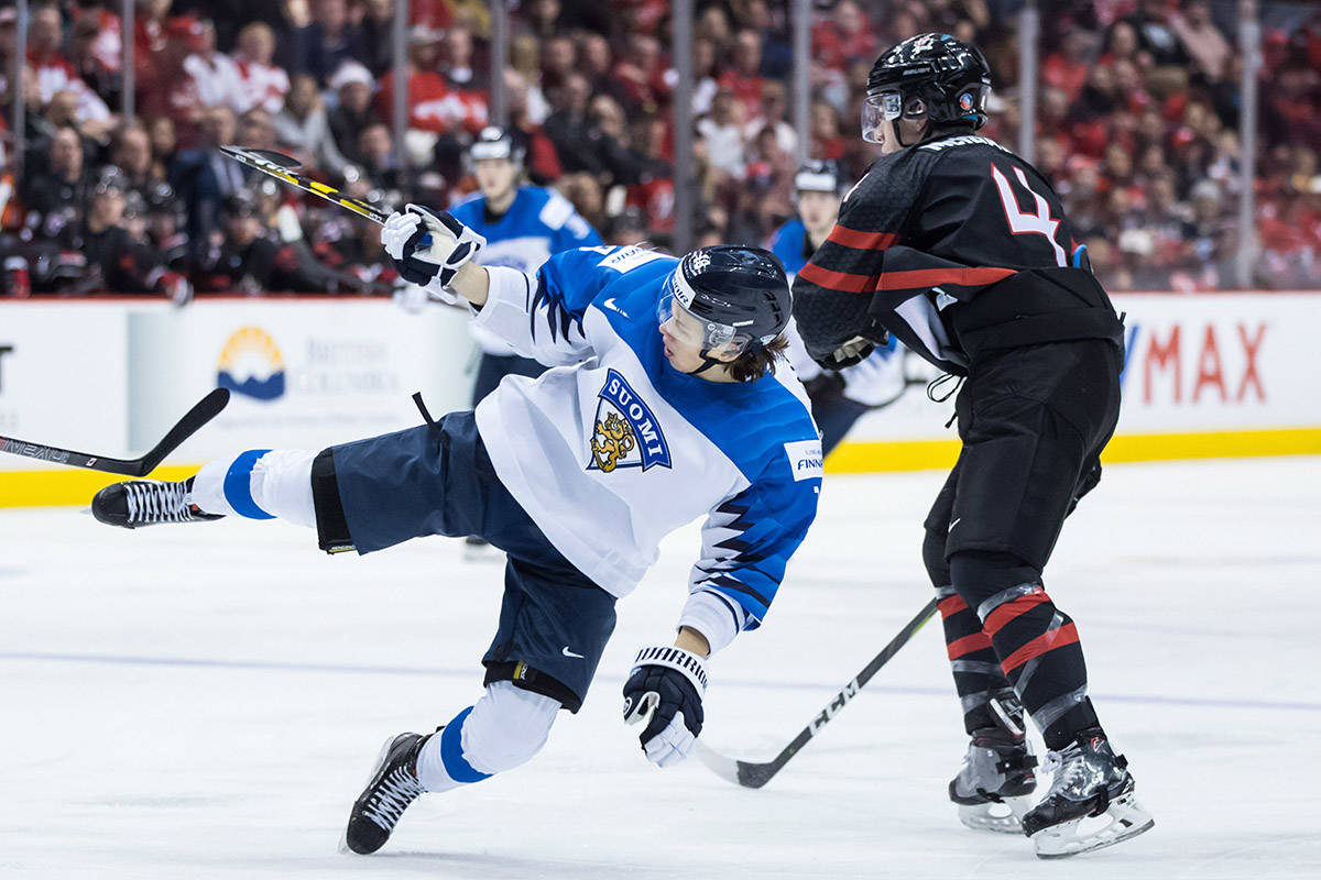 Canada's Jared McIsaac, right, checks Finland's Teemu Engberg during second period IIHF world junior hockey championship action in Vancouver on Wednesday, Jan. 2, 2019. THE CANADIAN PRESS/Darryl Dyck