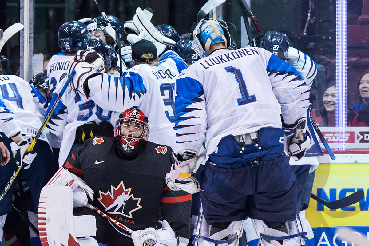 Canada goalie Michael DiPietro, front, kneels on the ice after Finland defeated Canada during overtime quarter-final IIHF world junior hockey championship action in Vancouver on Wednesday, Jan. 2, 2019. THE CANADIAN PRESS/Darryl Dyck