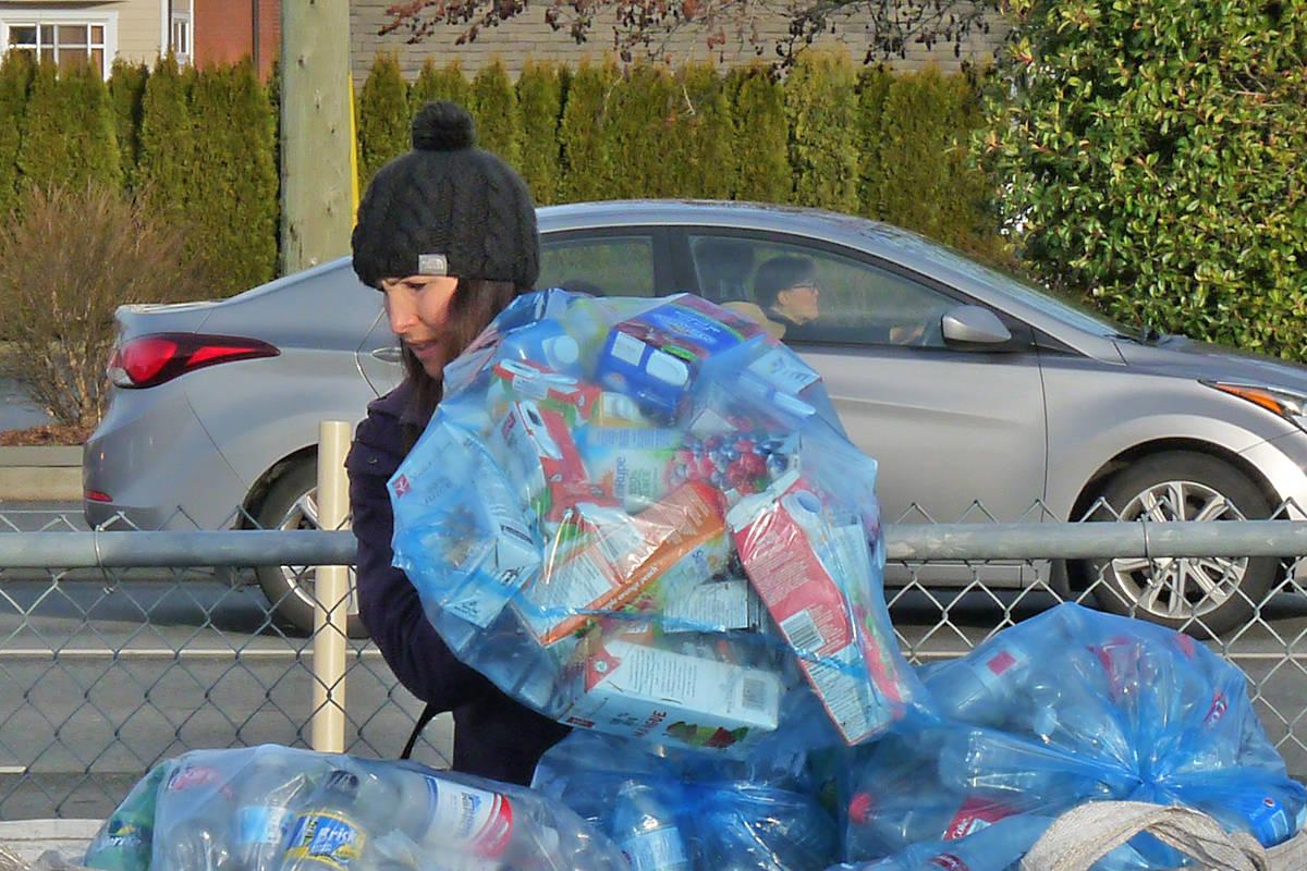 Extreme team parent Jaqueline Hamon wrestles some donations into place. Black Press photo