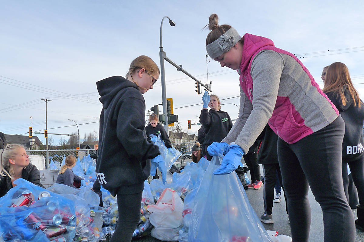Members of the Langley Extreme team sort bottles in Willoughby. Black Press Photo