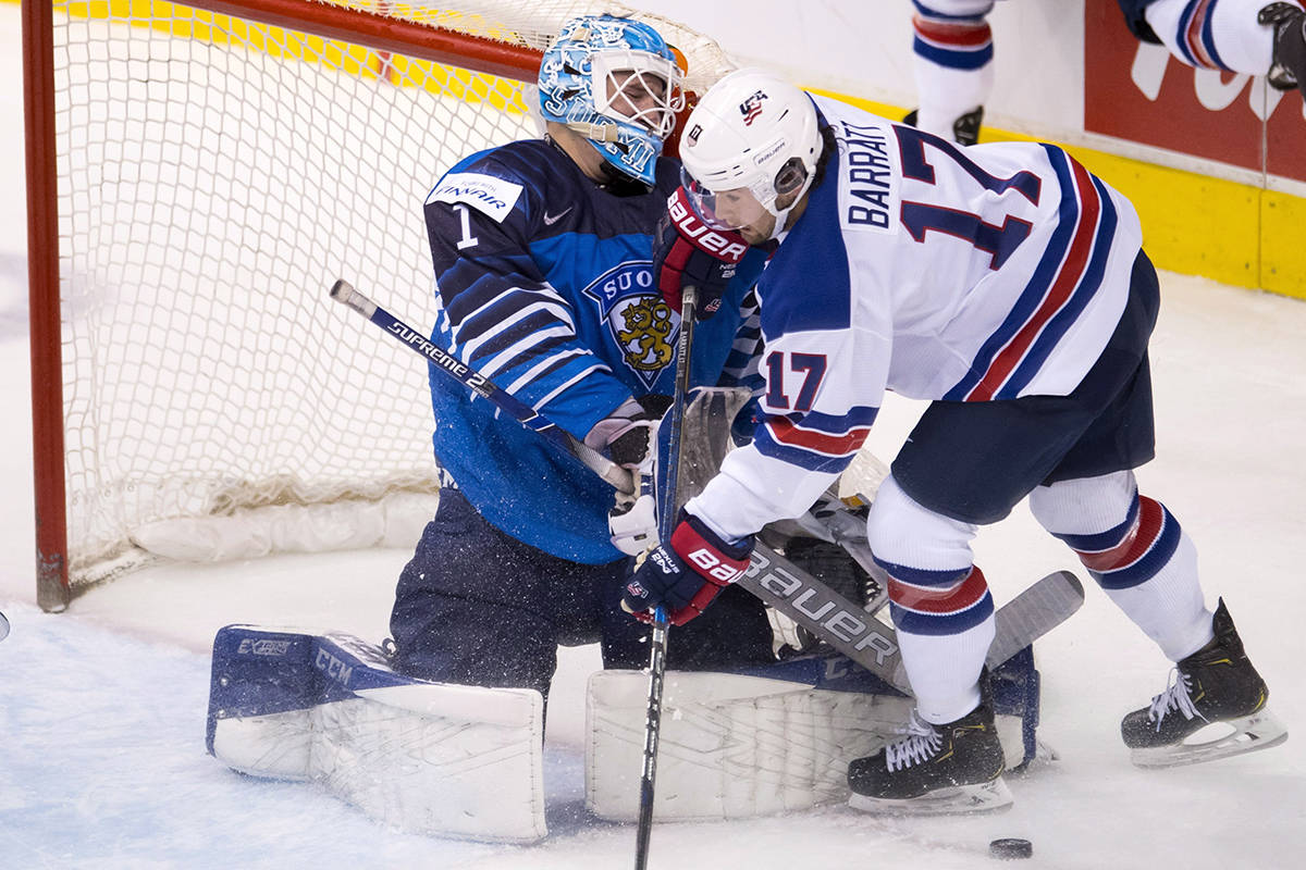 United States' Evan Barratt tries to get a shot on Finland goalie Ukko-Pekka Luukkonen during second period IIHF world junior hockey final action in Vancouver, Saturday, Jan. 5, 2019. THE CANADIAN PRESS/Jonathan Hayward