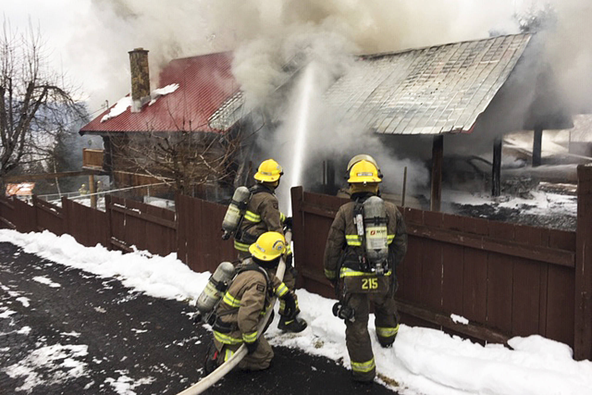 Columbia Shuswap Regional District firefighters attack a blaze in a home on Centennial Road in Blind Bay on Monday, Jan. 14.                                (Sean Coubrough photo)