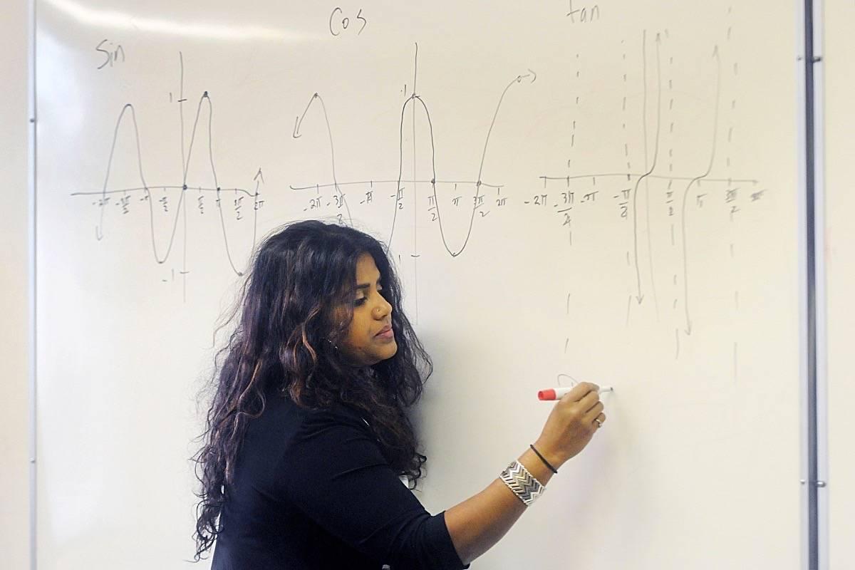 Kohila Sivas tutors students in Maple Ridge. (Colleen Flanagan/THE NEWS)