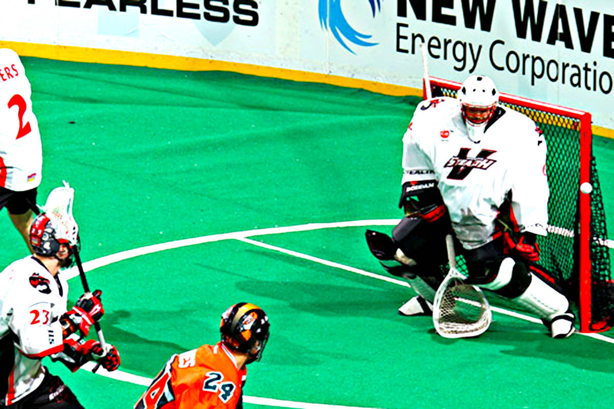 Eric Penney makes a save against the Buffalo Bandits. (Photo courtesy of Bill Wippert)