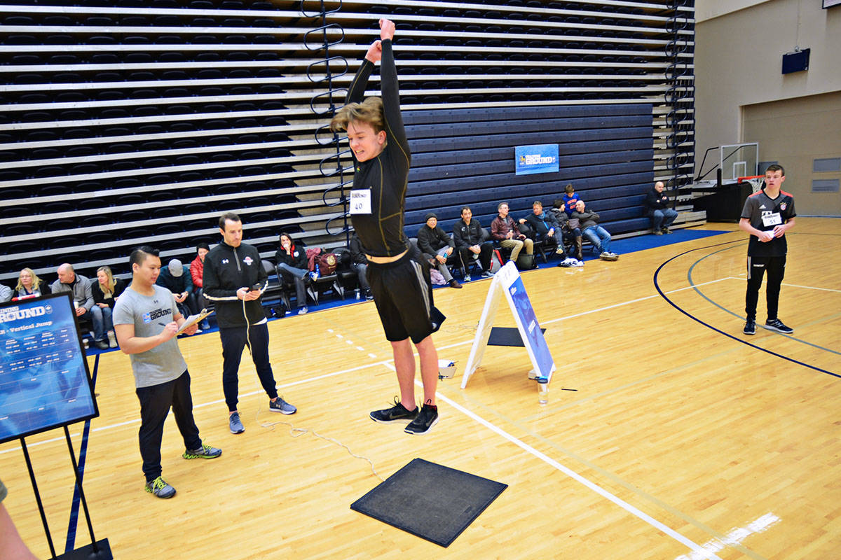 Braiden Davis came from Maple Ridge for the RBC Training Ground at the Langley Events Centre on Feb. 3. He and many other young athletes were tested on various sports-related competencies, including how high they can jump. (Heather Colpitts/Langley Advance)