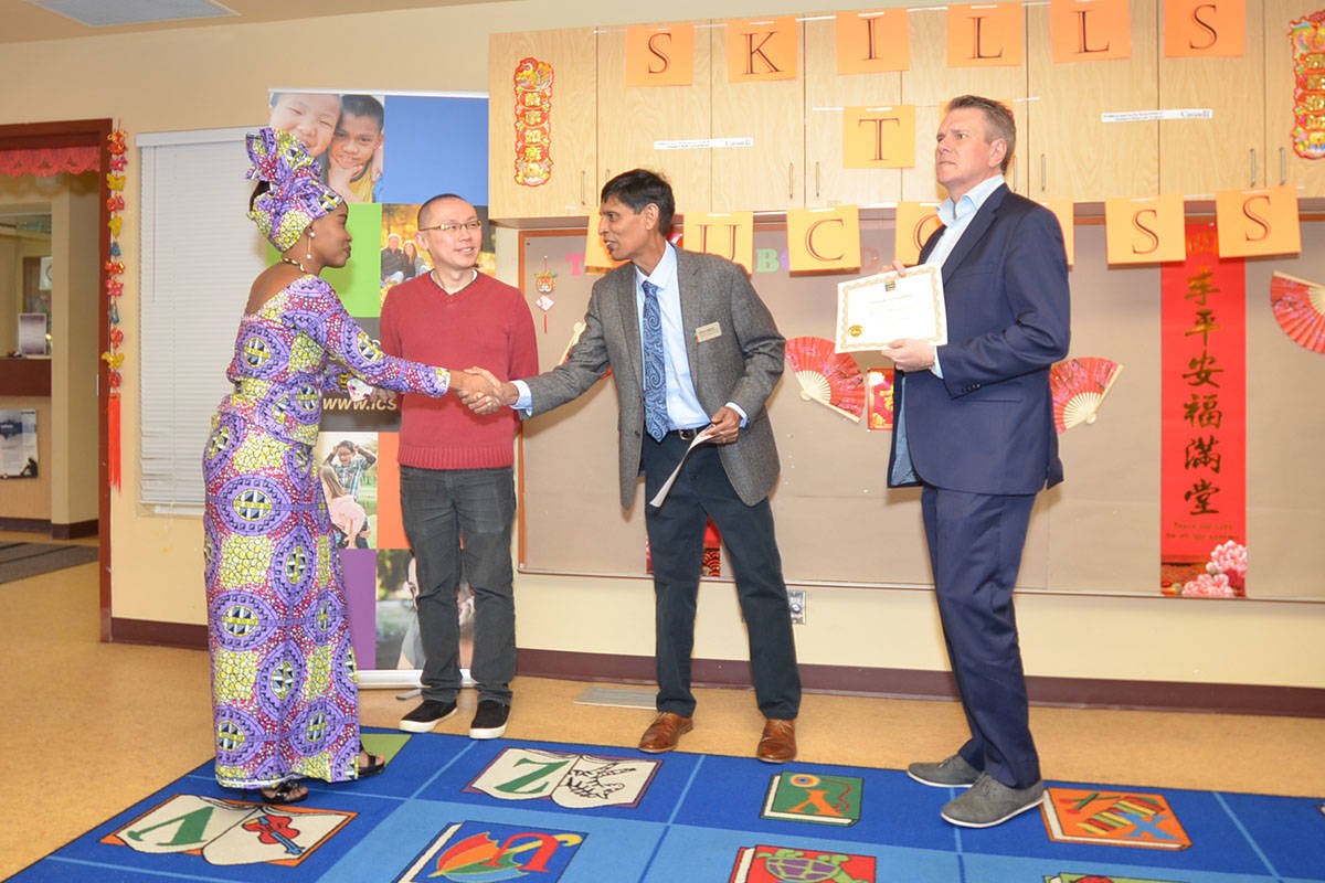 Rachel Mwindulwa took part in the first session of Skills to Success and was congratulated by Justin Yoe of Service Canada, Johnson Varghese with the Langley Community Services Society, and Cloverdale-Langley City MP John Aldag. (Heather Colpitts/Langley Advance)