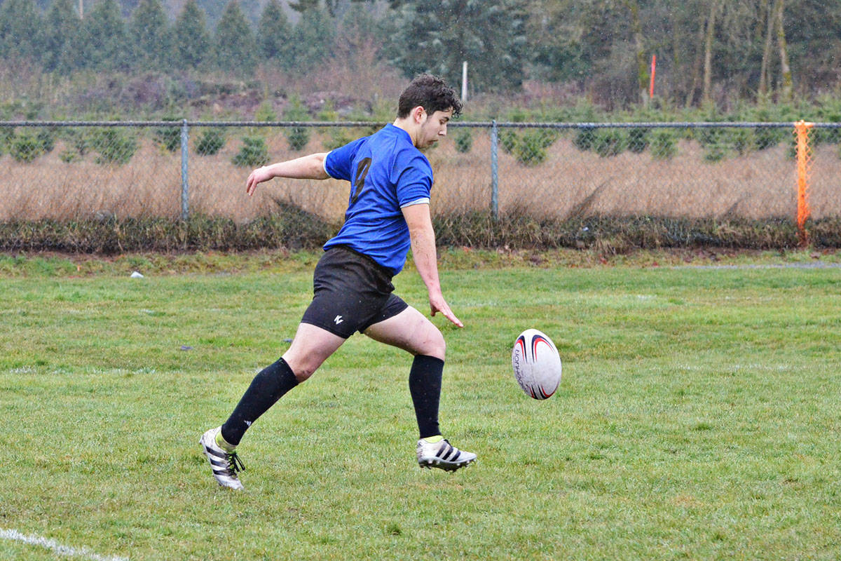 Drizzle throughout the day didn't stop students from playing hard at the Langley District 7s Rugby Tournament on Thursday. (Heather Colpitts/Langley Advance)