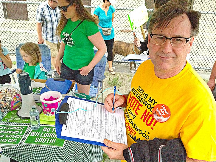 John Emery attended Sunday's protest and signed up for a community association.