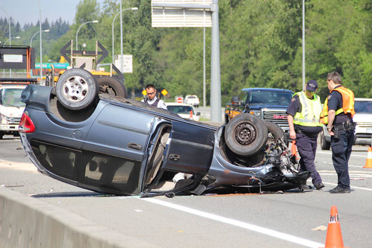 Two lanes of Highway 1 were closed as police investigated a rollover crash early May 6. (Shane MacKichan photo)