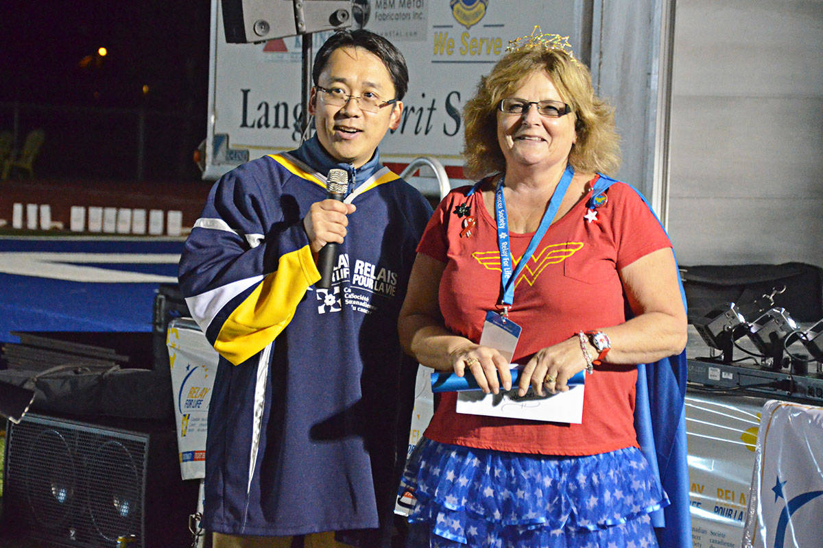 Langley 2017 Relay of Life master of ceremonies Darren Ng with Kari Medos, captain of the Gallery team. (Langley Advance files)