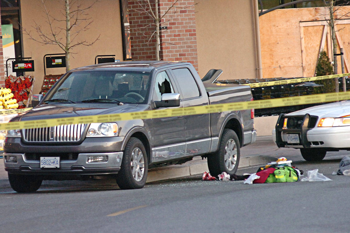 Kevin LeClair's truck, with a window shattered by bullets, outside the Walnut Grove IGA on Feb. 6, 2009. (Langley Advance files)