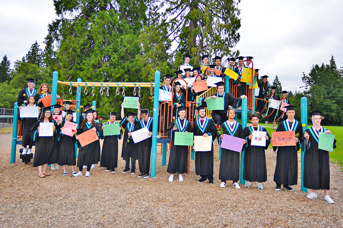 Walnut Grove Secondary students who attended Topham Elementary returned there for the Grad Walk on June 22. (Heather Colpitts/Langley Advance)