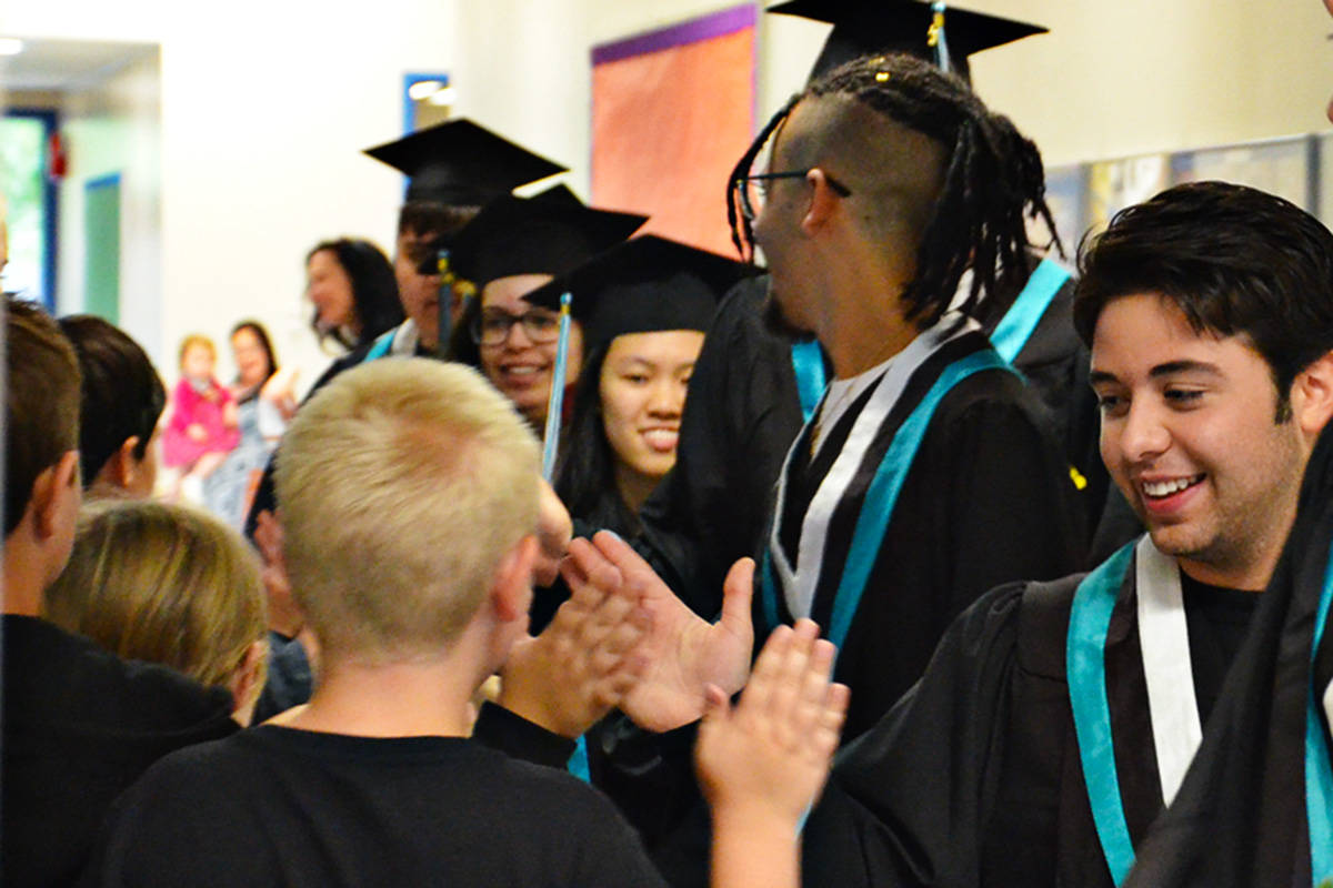 Topham Elementary students high-fived the Walnut Grove Secondary students who did their Grad Walk at the feeder elementary schools on June 22. (Heather Colpitts/Langley Advance)