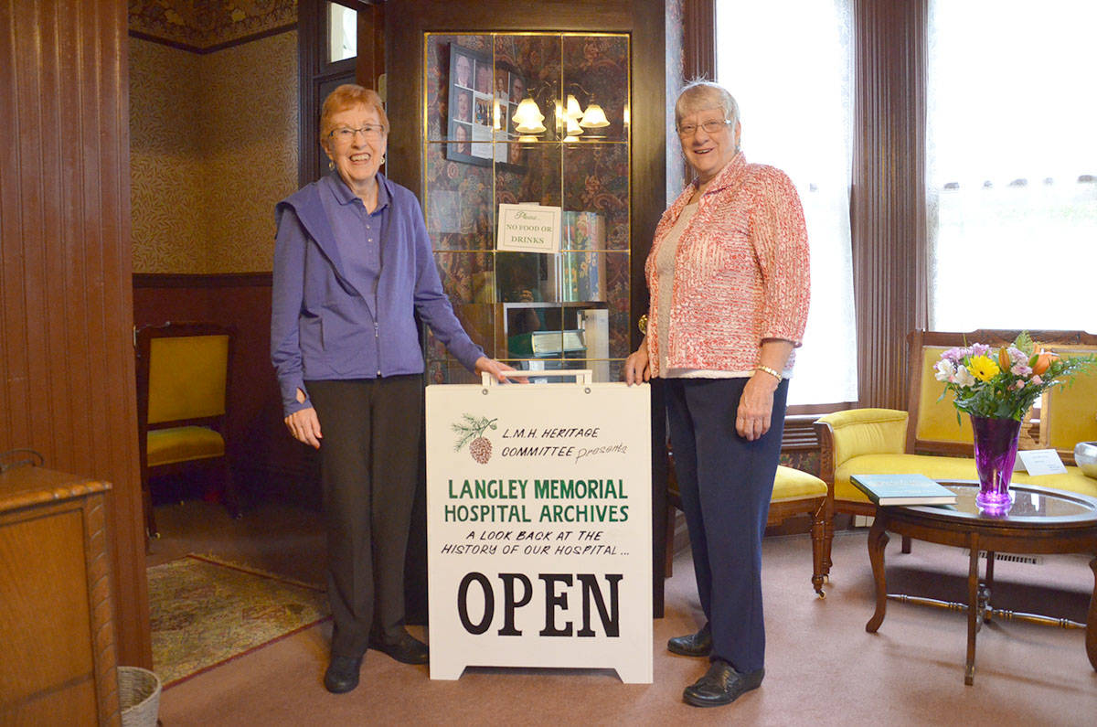 Doris Riedweg and Bev Rempel helped create a mini-museum last year about Langley memorial's history. (Heather Colpitts/Langley Advance)