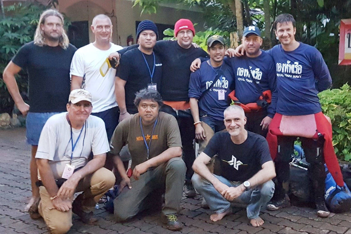 Erik Brown and other expert divers and people involved in the Thai cave rescue paused for a photo. (Erik Brown Facebook page)