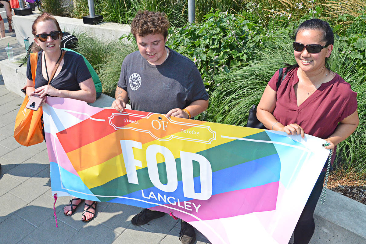 From left, Phoenix Khattab, Elliot Cluney, and Adrienne Barnett of Friends of Dorothy. (Matthew Claxton/Langley Advance)