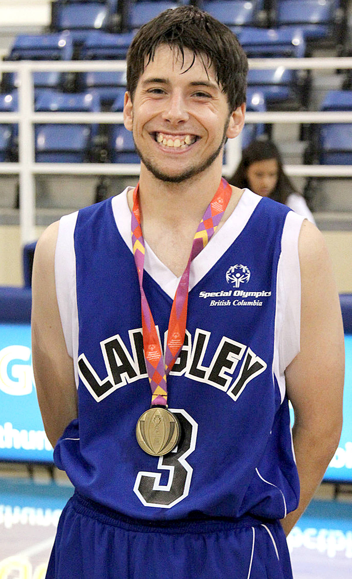 Special Olympics BC – Langley athlete Matthew Williams receives his medal at the 2014 Special Olympics Canada Summer Games in Vancouver. (Special Olympics British Columbia photo)