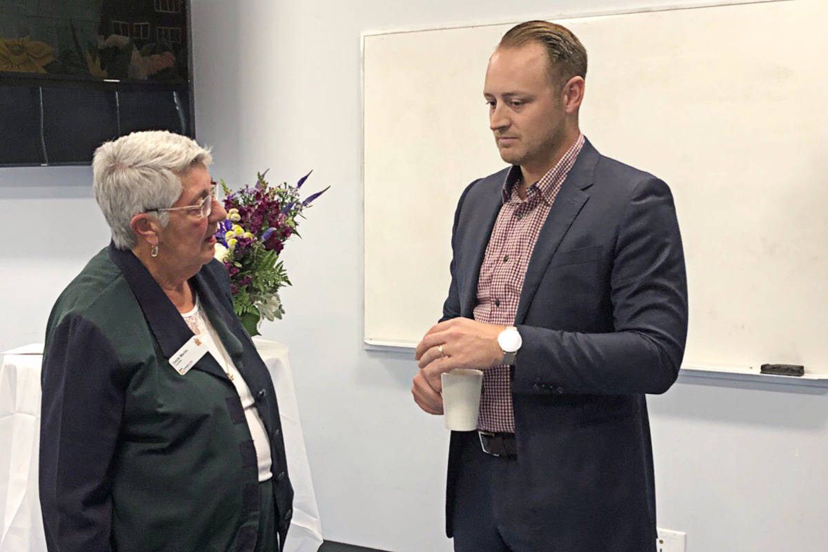 Langley City Councillor Gayle Martin with Tyler Mooi, the Telus director of community relations, at the announcement of a deal for fibre optic internet for the City. (Heather Colpitts/Langley Advance)