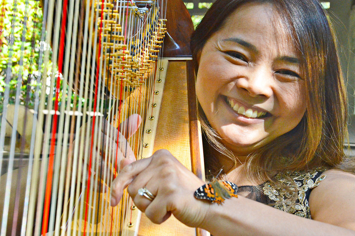 On Thursday, harpist Miya Otake performed at the Chartwell Langley Gardens butterfly release fundraiser for the fourth year in a row. This year, she had a special spectator. (Heather Colpitts/Langley Advance)