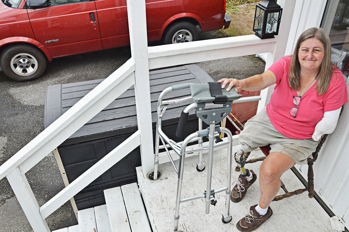 It takes Jean Moulton about four minutes to navigate the four steps at her Langley home. (Matthew Claxton/Langley Advance)